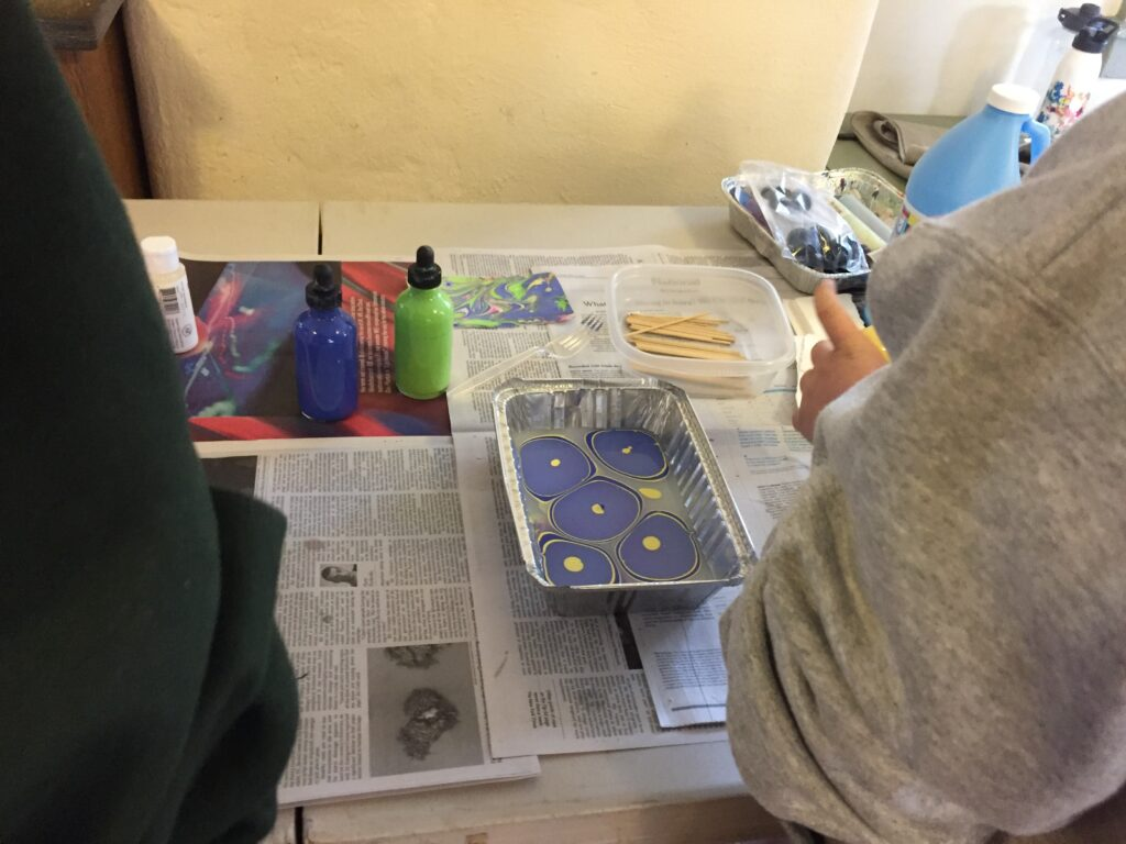 Paper Marbling during a Cadette Girl Scout Book Arts badge workshop, February 16, 2020
